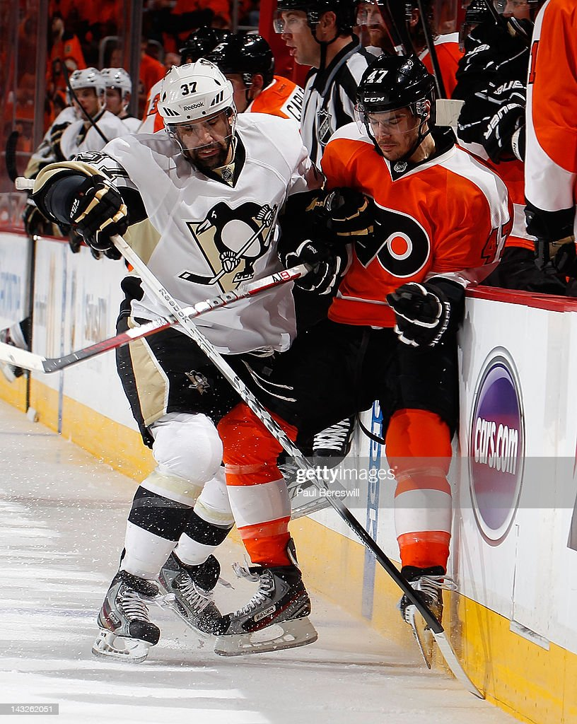 Brian Strait #37 of the Pittsburgh Penguins checks Eric Wellwood #47 of the Philadelphia Flyers in the second period of Game Six of the Eastern Conference Quarterfinals during the 2012 NHL Stanley Cup Playoffs at Wells Fargo Center on April 22, 2012 in Philadelphia, Pennsylvania.