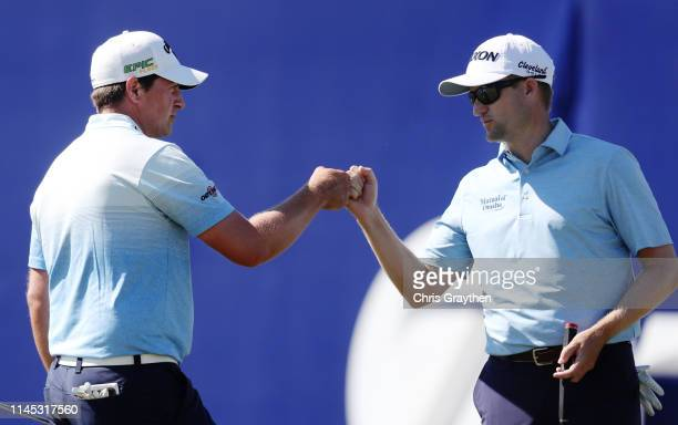 Brian Stuard of the United States and Russell Knox of Scotland react to a putt on the ninth green during the second round of the Zurich Classic at...