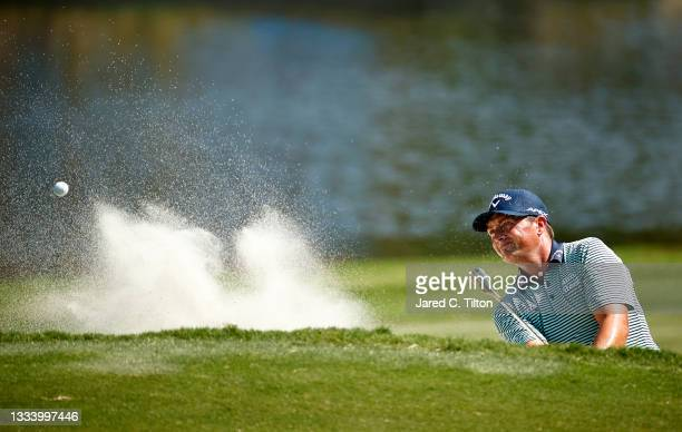 Brian Stuard of the United States plays his second shot from a greenside bunker on the 15th hole to hole out during the second round of the Wyndham...