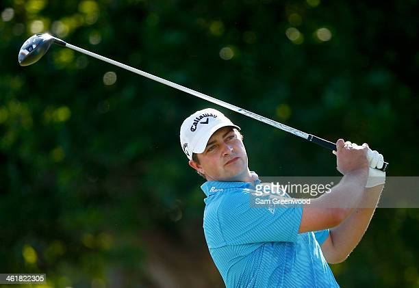 Brian Stuard plays a shot on the 1st hole during the third round of the Sony Open in Hawaii at Waialae Country Club on January 11 2014 in Honolulu...