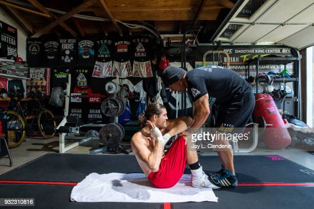 Brian 'TCity' Ortega a UFC featherweight fighter trains in the garage of his coach James Luhrsen in the Harbor City neighborhood of Los Angeles CA...