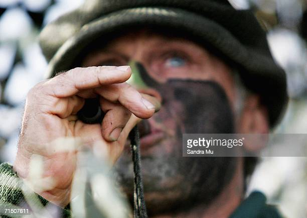 Brian Thomson calls the ducks from his maimai during a morning duck shooting at Mercer on May 27 2006 in Auckland New Zealand The first weekend in...