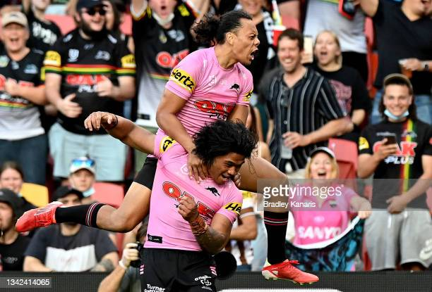 Brian To'o and Jarome Luai of the Panthers celebrate a try during the NRL Grand Final Qualifier match between the Melbourne Storm and the Penrith...