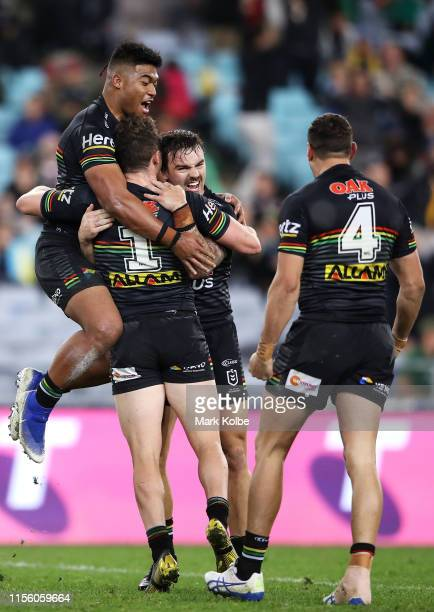Brian Too Dylan Edwards Wayde Egan and Brent Naden of the Panthers celebrate victory during the round 14 NRL match between the South Sydney Rabbitohs...