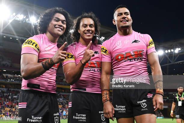 Brian To'o, Jerome Luai and Stephen Crichton of the Panthers pose as they celebrate victory during the NRL Preliminary Final match between the...