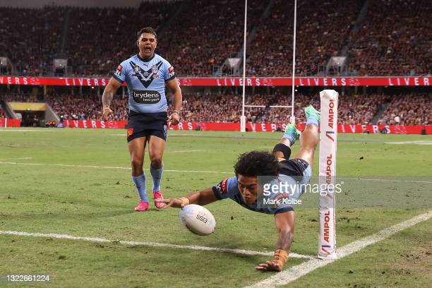 Brian To'o of the Blues scores a try during game one of the 2021 State of Origin series between the New South Wales Blues and the Queensland Maroons...