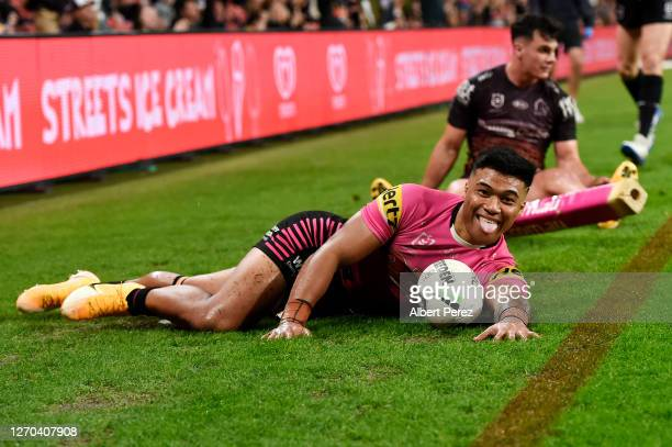 Brian To'o of the Panthers celebrates scoring a try during the round 17 NRL match between the Brisbane Broncos and the Penrith Panthers at Suncorp...