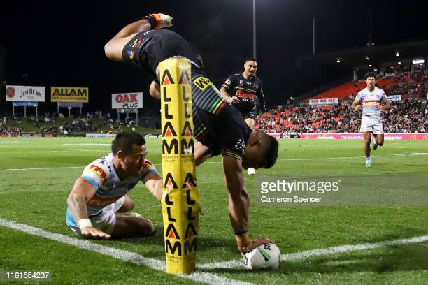 Brian To'o of the Panthers scores a try during the round 17 NRL match between the Penrith Panthers and the Gold Coast Titans at Panthers Stadium on...