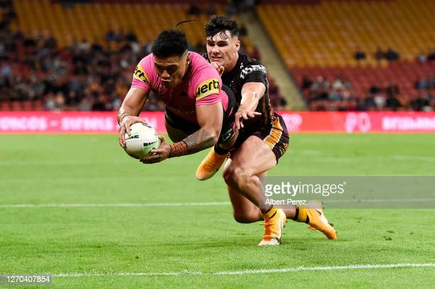 Brian To'o of the Panthers scores a try during the round 17 NRL match between the Brisbane Broncos and the Penrith Panthers at Suncorp Stadium on...