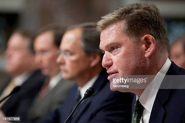 Brian Toohey president of the Semiconductor Industry Association right to left Richard Hillman managing director of forensic audits and investigative...