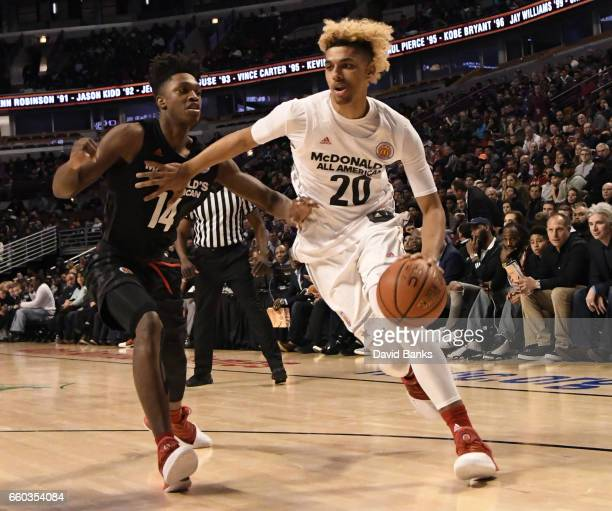 Brian Tugs Bowen II of the boys west team is defended by Lonnie Walker IV of the boys east team during the 2017 McDonalds's All American Game on...