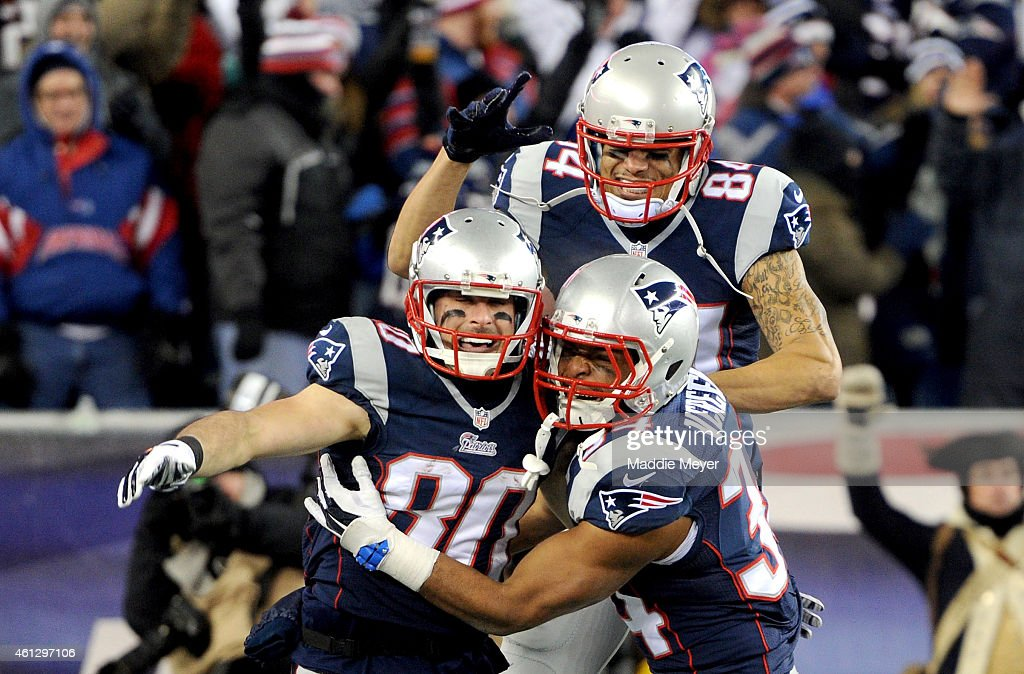 Brian Tyms #84, Shane Vereen #34, and Julian Edelman #80 of the New England Patriots react after Edelman caught a touchdown pass during the second half of the 2015 AFC Divisional Playoffs game against the Baltimore Ravens at Gillette Stadium on January 10, 2015 in Foxboro, Massachusetts.