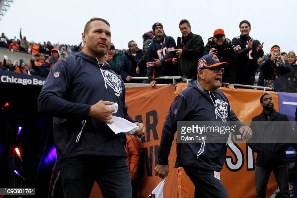 Brian Urlacher and Dick Butkus of the Chicago Bears take the field for their game against the Philadelphia Eagles of the NFC Wild Card Playoff game...
