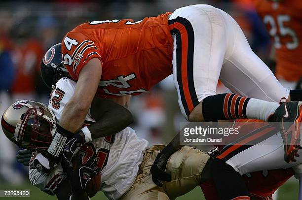 Brian Urlacher of the Chicago Bears tackles Frank Gore of the San Francisco 49ers October 29 2006 at Soldier Field in Chicago Illinois The Bears won...
