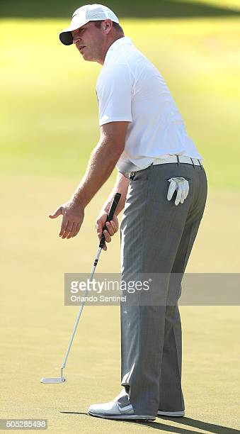 Brian Urlacher reacts as his putt does not fall on the 18th green during the Diamond Resorts Invitational at The Golden Bear Club at Keene's Point in...