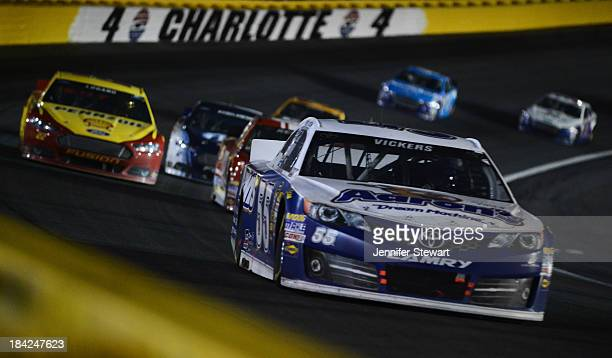 Brian Vickers driver of the Aaron's Dream Machine Toyota leads a pack of cars during the NASCAR Sprint Cup Series Bank of America 500 at Charlotte...