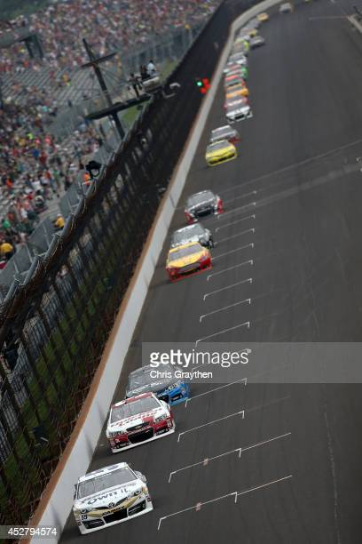 Brian Vickers driver of the Aaron's Dream Machine Toyota leads a pack of cars during the NASCAR Sprint Cup Series Crown Royal Presents The John Wayne...