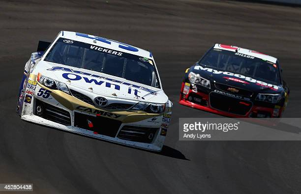 Brian Vickers driver of the Aaron's Dream Machine Toyota leads Austin Dillon driver of the Dow Mycogen Seeds Chevrolet during the NASCAR Sprint Cup...