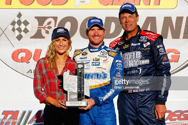 Brian Vickers driver of the Aaron's Dream Machine Toyota poses with Michael Waltrip driver of the MyAFibStorycom Toyota and his Dancing with the...
