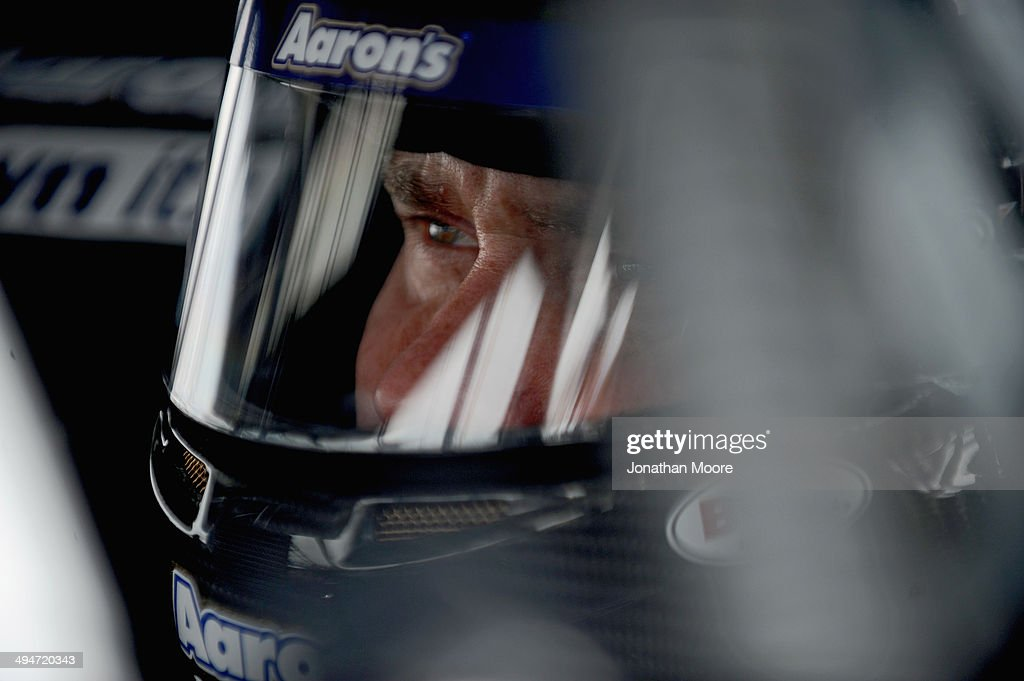 Brian Vickers, driver of the #55 Aaron's Dream Machine Toyota, sits in his car during qualifying for the NASCAR Sprint Cup Series FedEx 400 Benefiting Autism Speaks at Dover International Speedway on May 30, 2014 in Dover, Delaware.