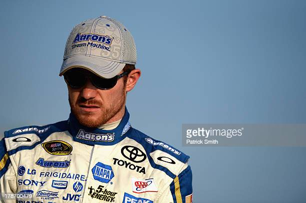 Brian Vickers driver of the Aaron's Dream Machine Toyota stands on the grstands on the gridduring qualifying for the NASCAR Sprint Cup Series...