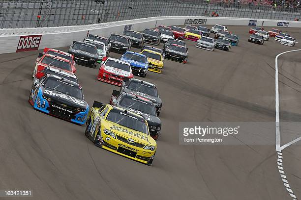 Brian Vickers driver of the Dollar General Toyota leads a group of cars during the NASCAR Nationwide Series Sam's Town 300 at Las Vegas Motor...