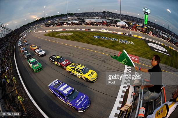 Brian Vickers driver of the FedEx Delivery Manager Toyota and Matt Kenseth driver of the Dollar General Toyota lead the field to the green flag for...