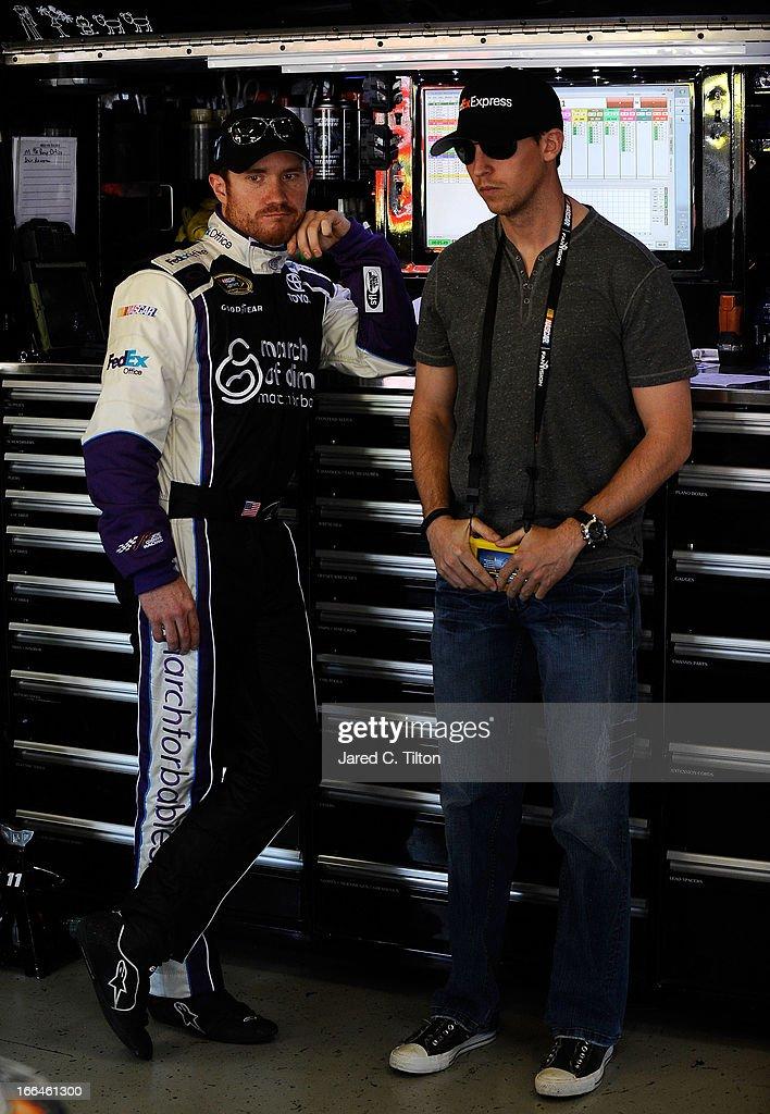 Brian Vickers, driver of the #11 FedEx Office/March of Dimes Toyota, talks with injured driver Denny Hamlin during practice for the NASCAR Sprint Cup Series NRA 500 at Texas Motor Speedway on April 12, 2013 in Fort Worth, Texas.