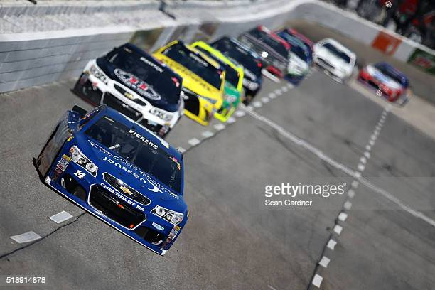 Brian Vickers driver of the Janssen/Arnie's Army Charitable Foundation Chevrolet leads a pack of cars during the NASCAR Sprint Cup Series STP 500 at...