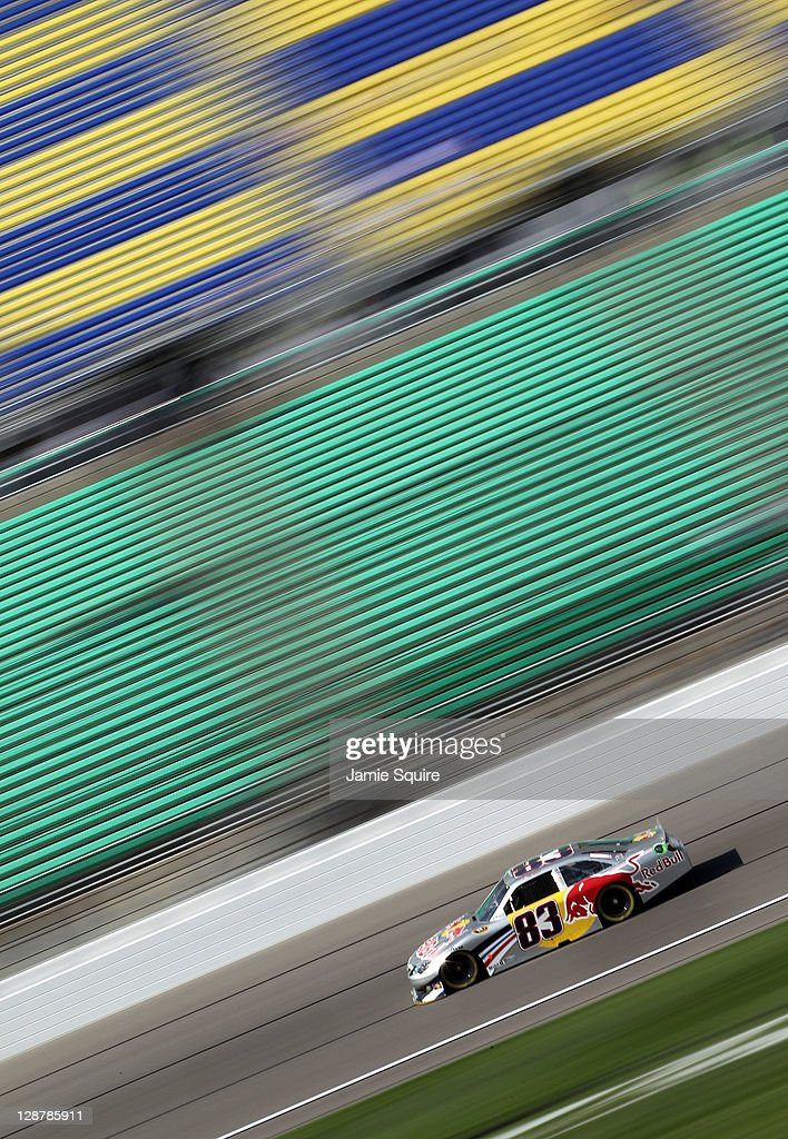 Brian Vickers, driver of the #83 Red Bull Toyota, drives during practice for the NASCAR Sprint Cup Series Hollywood Casino 400 at Kansas Speedway on October 7, 2011 in Kansas City, Kansas.