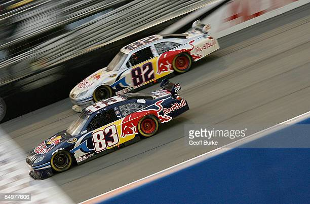 Brian Vickers driver of the Red Bull Toyota races teammate Scott Speed driver of the Red Bull Toyota during the NASCAR Sprint Cup Series Auto Club...
