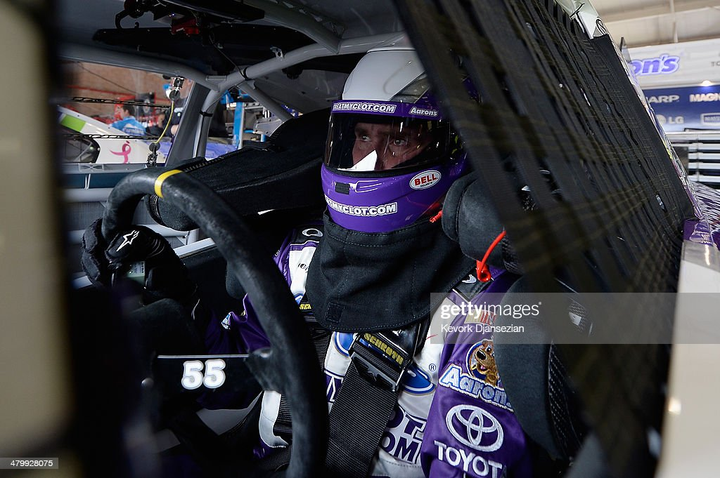 Brian Vickers, driver of the #55 TreatMyClot.com Toyota, sits in his car during practice for the NASCAR Sprint Cup Series Auto Club 400 at Auto Club Speedway on March 21, 2014 in Fontana, California.