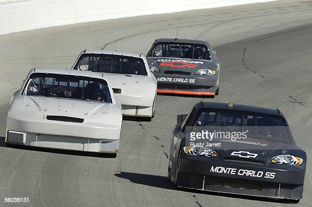 Brian Vickers leads Martin Truex Jr Carl Edwards and Jeff Burton during the NASCAR Car Of Tomorrow test session on October 31 2005 at the Atlanta...