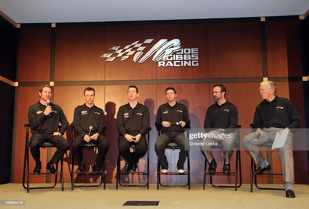 Brian Vickers, Matt Kenseth, Kyle Busch, Denny Hamlin, J.D. Gibbs and Joe Gibbs of Joe Gibbs Racing speak to the media during the 2013 NASCAR Sprint Media Tour on January 24, 2013 in Concord, North Carolina.