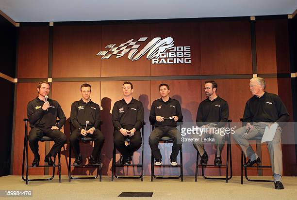 Brian Vickers Matt Kenseth Kyle Busch Denny Hamlin JD Gibbs and Joe Gibbs of Joe Gibbs Racing speak to the media during the 2013 NASCAR Sprint Media...