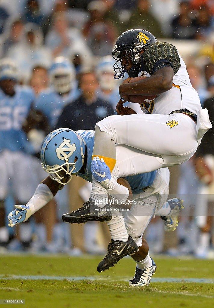 Brian Walker #5 of the North Carolina Tar Heels upends Kwashaun Quick #2 of the North Carolina A&T Aggies during their game at Kenan Stadium on September 12, 2015 in Chapel Hill, North Carolina.