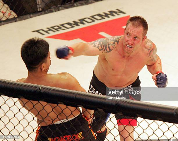 Brian Warren delivers a punch to opponent Cung Le during the StrikeForce mixed martial arts event at HP Pavilion on June 9 2006 in San Jose California