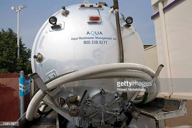 Brian Warren of Aqua Wastewater Management pumps out trap grease into his tank truck on June 1 2007 in Philadelphia Pennsylvania The trap grease will...