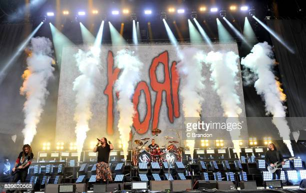 Brian Welch Johnathan Davis Ray Luzier and James Shaffer of Korn perform on stage during Day 2 of the Reading Festival at Richfield Avenue on August...