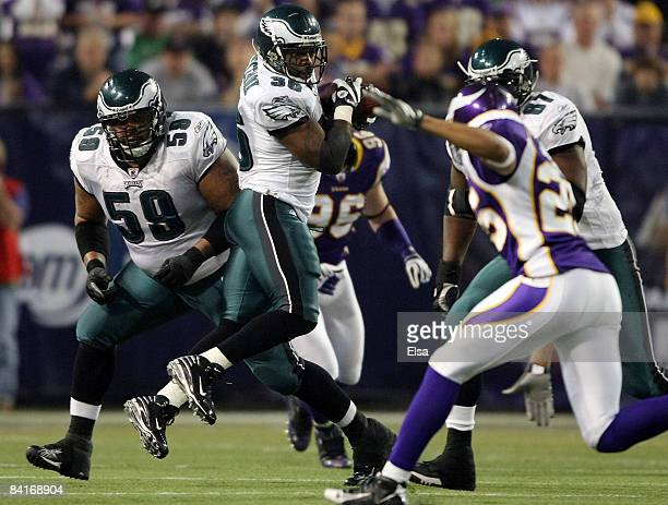 Brian Westbrook of the Philadelphia Eagles catches the ball and carries it 71 yards for the touchdown as teammate Nick Cole looks on during the NFC...