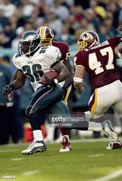 Brian Westbrook of the Philadelphia Eagles runs with the ball against the Washington Redskins on October 5 2003 at Lincoln Financial Field in...