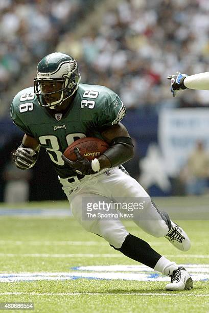 Brian Westbrook of the Philadelphia Eagles runs with the ball during a game against the Dallas Cowboys on October 12 2003 at Texas Stadium in Irving...