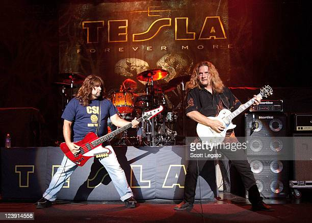 Brian Wheat and Frank Hannon of Tesla performs at the DTE Energy Center on August 28 2011 in Clarkston Michigan