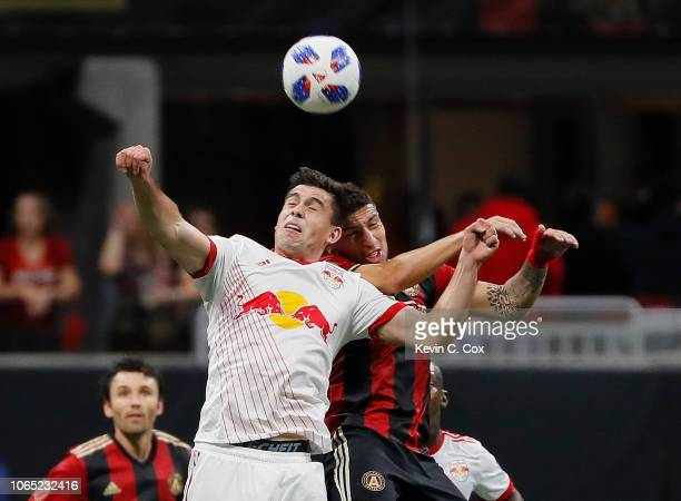 Brian White of New York Red Bulls challenges for a header against Eric Remedi of Atlanta United during the MLS Eastern Conference Finals between...