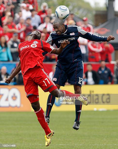 Brian White of Toronto FC heads the ball with Cory Gibbs of the New England Revolution during a MLS game at BMO Field May 22 2010 in Toronto Ontario...