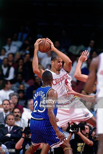 Brian Williams of the Los Angeles Clippers grabs the rebound against Nick Anderson of the Orlando Magic on December 5 1995 at the Los Angeles Sports...