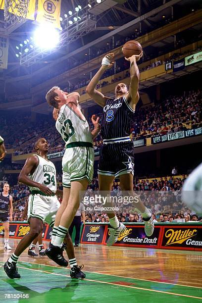 Brian Williams of the Orlando Magic shoots against Larry Bird of the Boston Celtics circa 1991 at the Boston Garden in Boston Massachussetts NOTE TO...