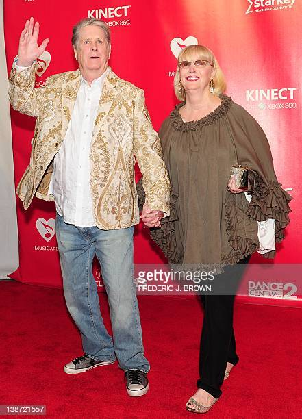 Brian Wilson and Melinda Ledbetter pose on arrival for the 2012 MusiCares Person of the Year Tribute honouring Paul McCartney as Person of the Year...