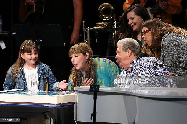 Brian Wilson blows out a birthday candle on his cake with daughter Carnie Wilson as his granddaughter Lola Sofia Bonfiglio and guests celebrate his...
