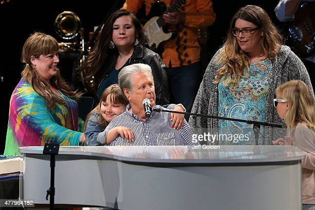 Brian Wilson gets a hug from his granddaughter Lola Sofia Bonfiglio as he celebrates his 73rd birthday with daughter Carnie Wilson and guests at The...